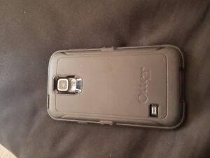 2 samsung s5 neo with one otter box and extra battery