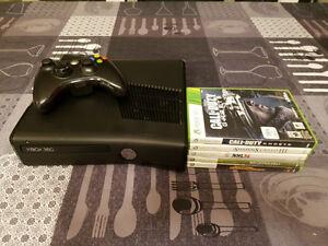 Xbox 360 slim avec 5 jeux.