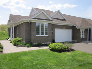 Townhouse for sale in Dieppe Fox Creek Golf Course