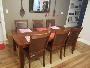 Dining table set with built in leaf