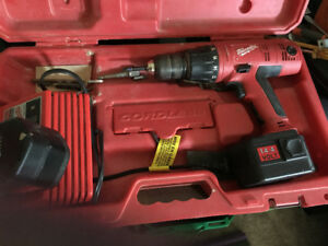 Older Milwaukee 14.4volt cordless drill with hammer option.