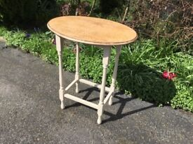 Very attractive oval oak side table