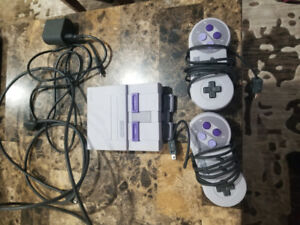Super Nintendo with 2 controllers