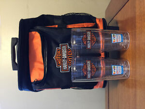 Harley Davidson cooler bag and travel mugs.