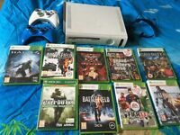 Used Xbox 360 with 2 whirles controllers 9 games