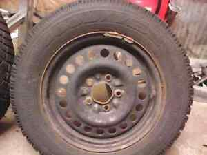 4 Goodyear Nordic winter tires with rims. 215 60  r15