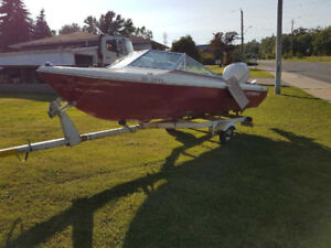 Thundercraft boat with 60hp Evinrude and trailer $500