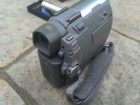 Sony handheld camcorder with cables and tapes