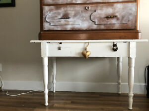 White wooden table (under brown dresser)