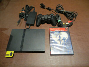PS2 Slim with Kingdom Hearts, controller, memory card, cables