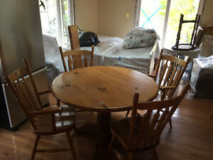 """48""""- 72"""" round pine table with 6 chairs and two leaves"""