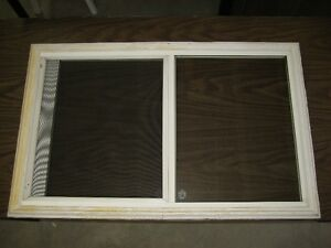Window insert for a steel exterior door