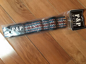 brand new guitar strap still in the bag