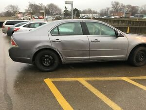 2007 Ford Fusion AWD  *Low Kms* *$4500* some aesthetic damage