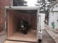 Pick up truck and enclosed 6by10 trailer.