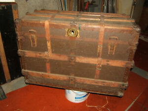 Vintage shipping trunk. Leather straps.