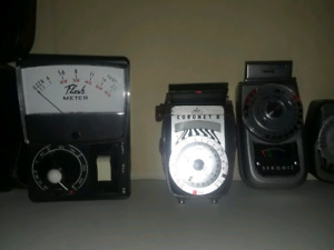 Vintage camera flashes and light meters. $30