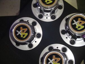 Brand new,never installed  chevy truck WHEEL CENTERS 4X4