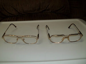 Two Pairs Of Mens Eyeglass Frames.