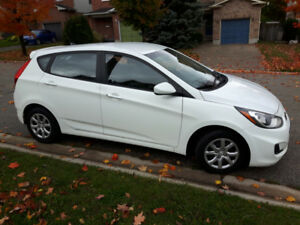 2013 Hyundai Accent Hatchback, comes with snow tires on rims