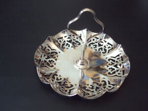 Silver candy dish with central vertical handle