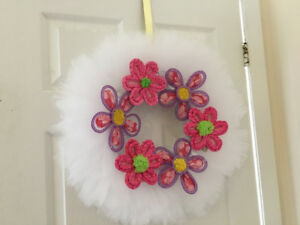 White tulle wreath with flower accents, little girl