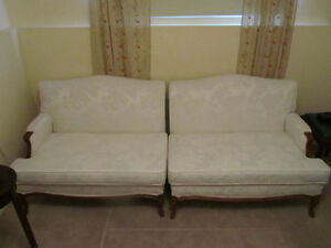 TWO ANTIQUE LOVESEATS