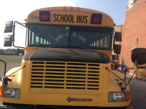 2000 International yellow school buses for sale.