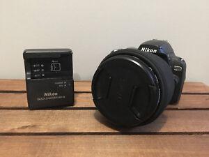 Nikon D40X, battery, Sigma 10-20mm lense and bag