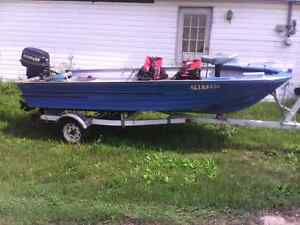 Boat motor and trailer looking for cash