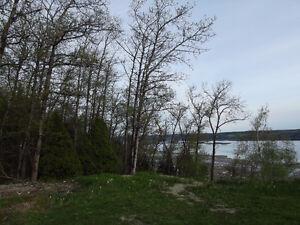 Beau grand terrain vue sur le fjord !!!!