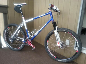 """21"""" 2009 Rocky Mountain Blizzard with two custom wheel sets."""