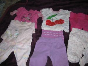 5 pants and 3 tops size 0 to 3 months