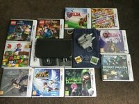NEW Nintendo 3DS XL + 12 games and extras. As new condition!
