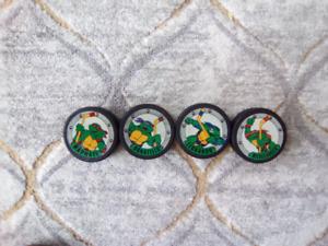 Teenage mutant Ninja turtles pucks $10 for all four.