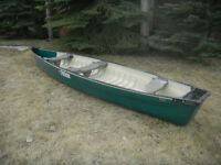 Canoe 16 feet square end sits great in the water next to new