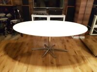 Oval white dining table with 6 chairs