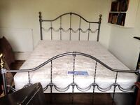 SOLD. King size iron bed and mattress