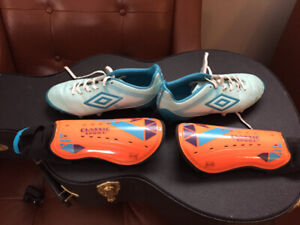 Soccer cleats and shin guards (women size 8)