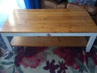 Wooden coffee table with draw