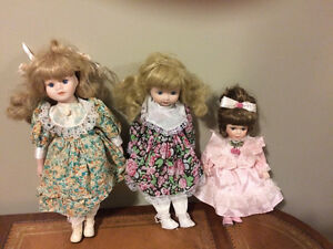 3 vintage porcelain  dolls all excellent condition   20.00 each