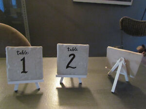 WEDDING DECOR-CERAMIC TILE TABLE NO'S W/WHITEWASHED EASELS