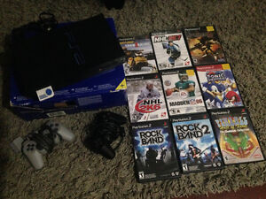PS2, 2 controllers, memory card and 9 games