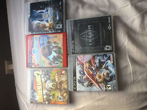 PS3 super slim. 2 controllers and 5 games