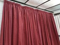 Long, thick, lined and insulating, deep red pair of curtains