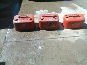 # boat gas cans 2 six gallon and 1 five gallon