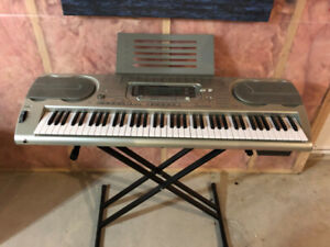Casio WK 3300 | With sustain pedal, stand, and stool.