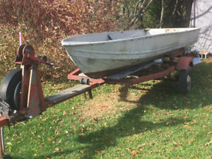 Solid 17' steel tilt trailer with 14' Sea Nymph aluminum boat.