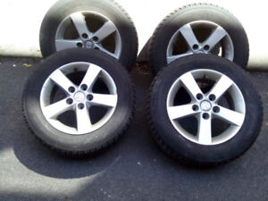 "4 winter tires with 15"" Mazda mags"