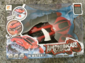 Amphibious stunt car goes in water brand new sealed